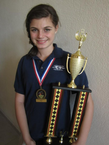 Andi sporting her trophy and medal