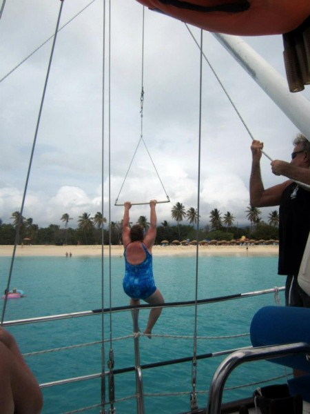 Aunt Sue braves the swing and plunges into Mullet Bay
