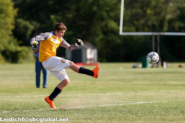 Tanner playing goalie for Central High school's soccer team